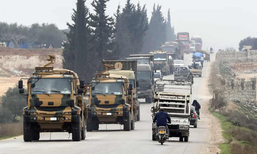 A Turkish military convoy travels through the east of Idlib, Syria