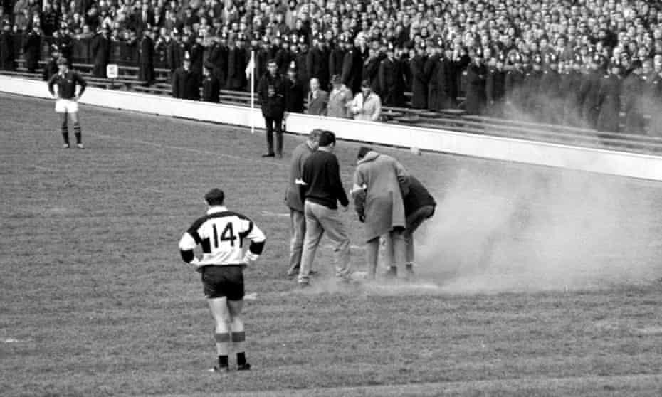 Anti-apartheid demonstrators throw a smoke bomb on to the Twickenham pitch
