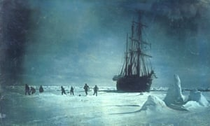 men play football on the ice next to the ship Endurance