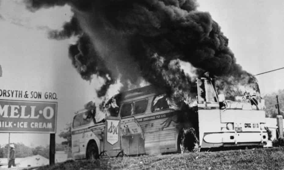 A Freedom Rider bus in flames in Anniston, Alabama, May 1961