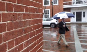 A pedestrian walks by the wall where a slave auction marker and a plaque explaining the city's slave auction history has gone missing in Charlottesville, Virginia, on 6 February.