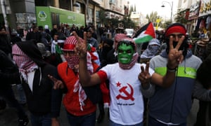 Palestinians protest in the West Bank town of Hebron on 13 December against Trump's decision to recognise Jerusalem as the capital of the Israel last week.