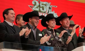 Professional bull rider J. B. Mauney ringing the opening bell of the New York Stock Exchange today.