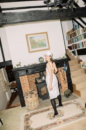 White: dress, hat, socks at Max Mara. Heels by Jimmy Choo
