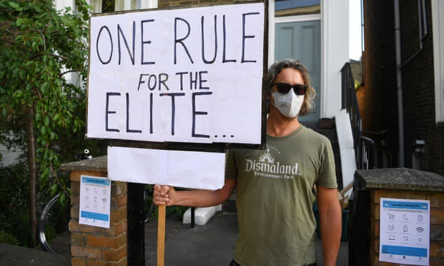 A protester outside the home of Dominic Cummings, London, 25 May.