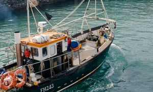 Fisherman Jonathan Fletcher heads out to sea in his boat in Porthleven