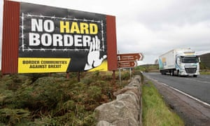 A lorry passing an anti-Brexit billboard.