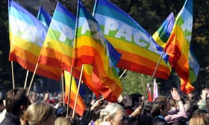 Participants of Belgrade Gay Pride parade wave flags in Belgrade