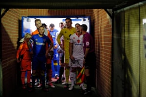 The two captains line up their teams in the tunnel before kick-off.