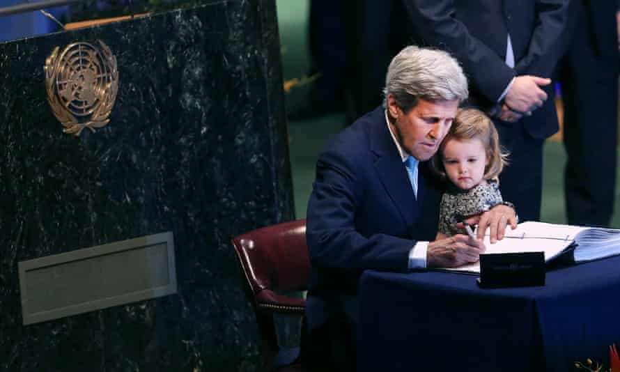 The US secretary of state, John Kerry, holds his granddaughter for the signing of the accord at the United Nations Signing Ceremony for the Paris Agreement climate change accord in New York.