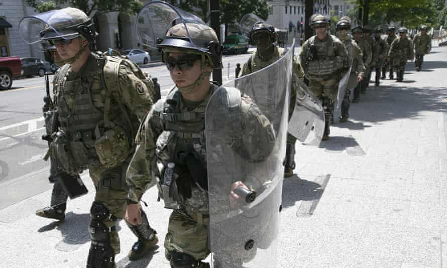 Members of an airborne military unit are deployed on the streets of Washington DC on Thursday.