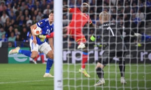 Victor Osimhen of Napoli dinks the ball over Leicester keeper Kasper Schmeichel.
