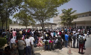 People gather in front of the US embassy in Port-au-Prince, Haiti, on Friday.