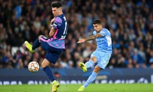 Joao Cancelo of Manchester City scores.