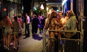 People gathering outside a bar in east London.