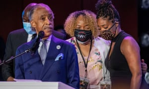 Actor Tiffany Haddish hugs Eric Garner's mother, Gwen Carr, while Reverend Al Sharpton speaks during a memorial service for George Floyd.