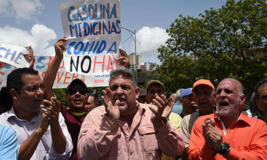 Opponents of Venezuela's President Nicolas Maduro demonstrate in July. Washington has frozen all of Venezuela's assets in the US.