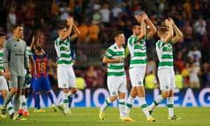 Celtic players applaud their travelling fans.