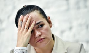Svetlana Tikhanovskaya resting her head on one hand at a press conference