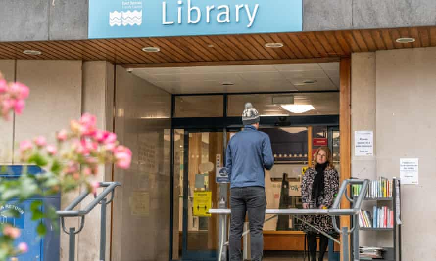 A reader uses Eastbourne public library's click-and-collect service during lockdown in November.