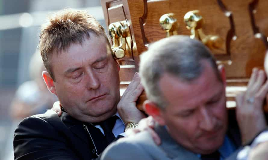 Jimmy White carries Alex Higgins's coffin in 2010. The funeral was delayed to allow White to travel back from Thailand.