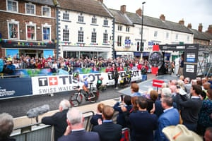The crowds at the start in Northallerton watch the rider take off.