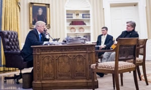 Donald Trump phone conversations with world leaders, Washington DC, USA - 28 Jan 2017<br>Mandatory Credit: Photo by REX/Shutterstock (8137190p) National Security Advisor Michael Flynn and Senior Counselor to the President Steve Bannon, sit nearby as United States President Donald Trump speaks on the phone with Prime Minister of Australia, Malcolm Turnbull in the Oval Office Donald Trump phone conversations with world leaders, Washington DC, USA - 28 Jan 2017 The call was one of five calls with foreign leaders scheduled for Saturday