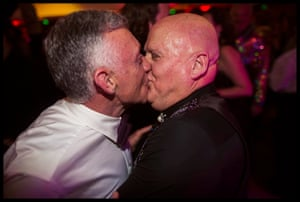A couple kiss at the Coming Back Out ball.