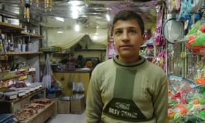 A 14-year-old selling toys and water pipes, who says the shop in east Aleppo belongs to him.