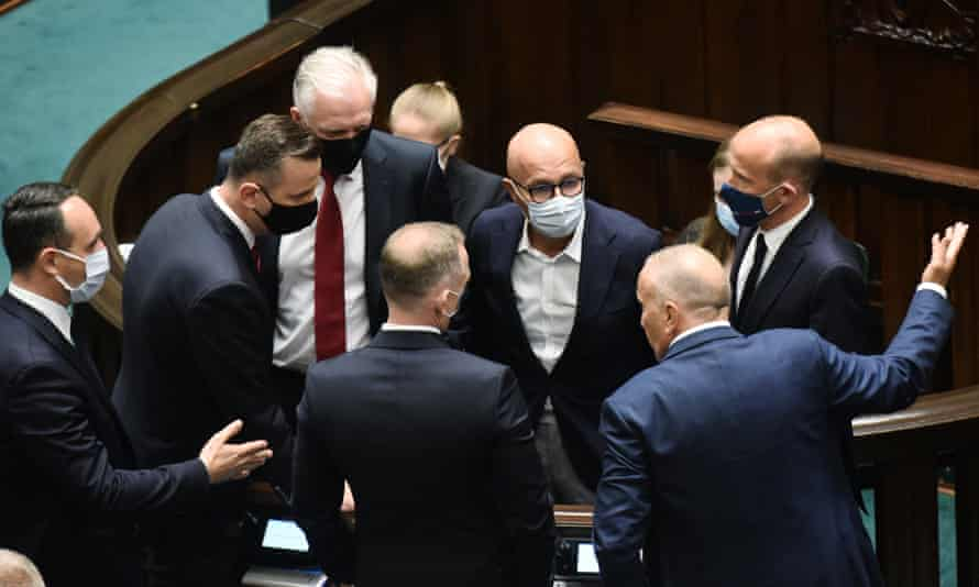 Polish MPs discuss the bill in parliament, including Jarosław Gowin (3rd left), who was fired as deputy prime minister