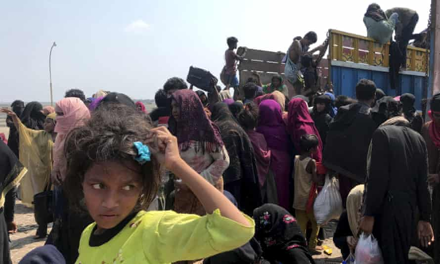 Rohingya refugees gather after being rescued in Teknaf near Cox's Bazar, Bangladesh, on 16 April.