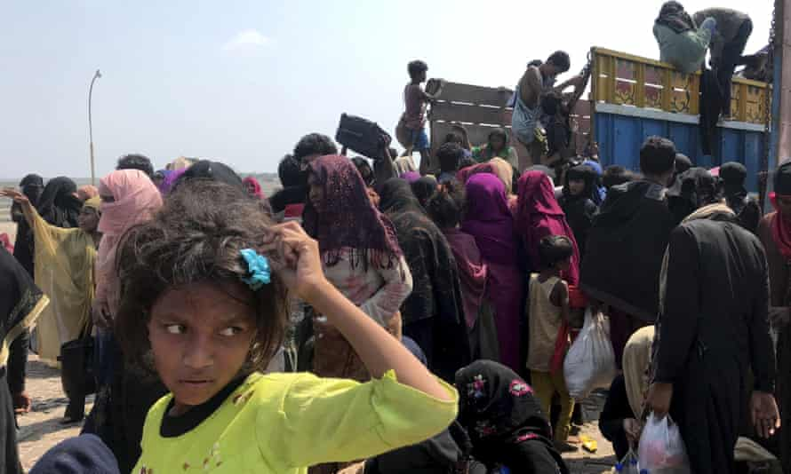 Rohingya refugees gather after being rescued by the Bangladeshi coastguard on Thursday. They had been drifting for weeks after failing to reach Malaysia.