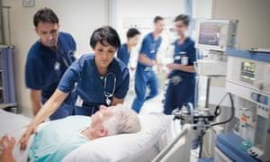 Two doctors prepare patient before medical procedure