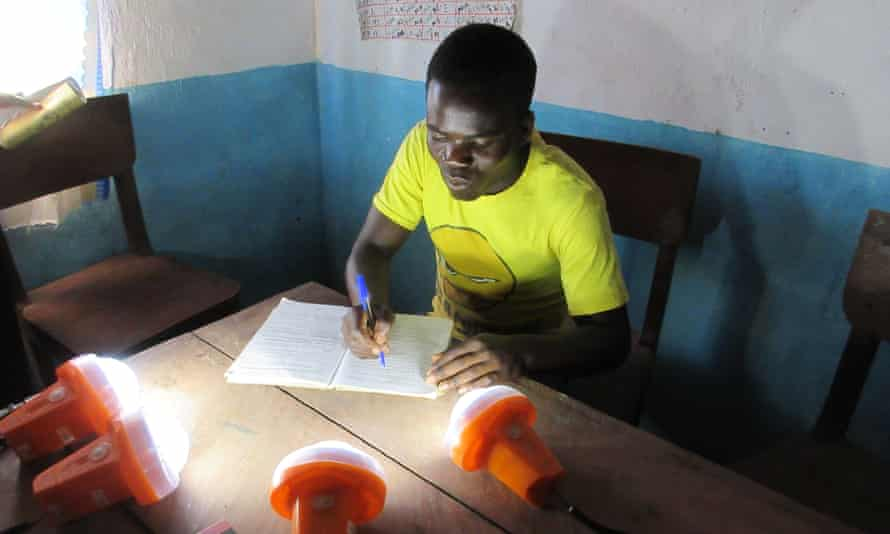 Working by the light of solar lamps at St Martin's school in Nambuma, Malawi, July 2015.
