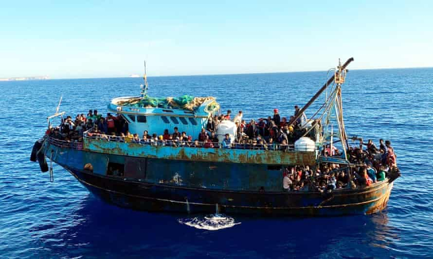 Migrants arrive at Lampedusa Island on Sunday. A further four boats arrived overnight after people smugglers too advantage have taken advantage of calm seas.