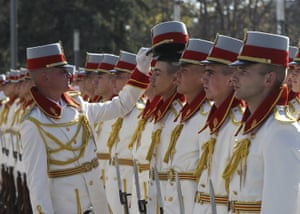 Chisinau, Moldova. A member of the Honor Guard Company of the Moldovan National Army has his hat corrected as they wait for the to welcome Turkish President Recep Tayyip Erdogan at the Presidential Palace