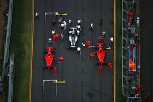 Lewis Hamilton, Kimi Raikkonen and Sebastien Vettel prepare for the Australian Grand Prix.