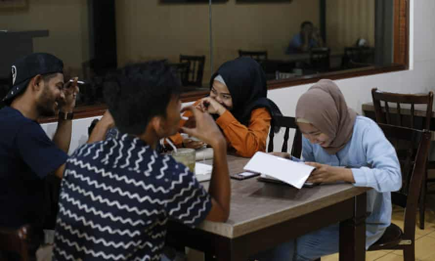 People sit at a restaurant in Bireuën, a district in Aceh province