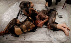 Extinction Rebellion activists covered in fake crude oil protest at a National Portrait Gallery exhibition sponsored by BP.