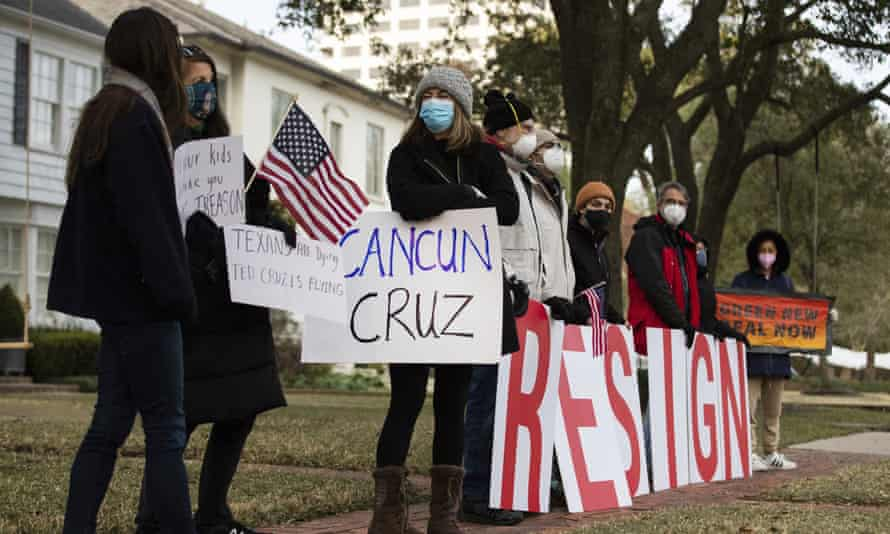 Demonstrators stand in front of Ted Cruz's home in Houston demanding his resignation on Thursday.