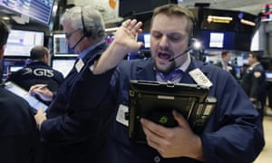 Traders on the floor of the New York Stock Exchange as US markets recover.