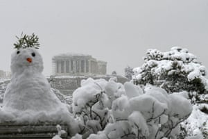 A snowman is seen in front of the Parthenon temple.