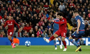 Mohamed Salah scores his first and Liverpool's second goal during the win at Anfield.