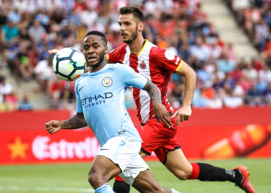Raheem Sterling chases the ball with Alcalá in hot pursuit during Manchester City's pre-season friendly against Girona
