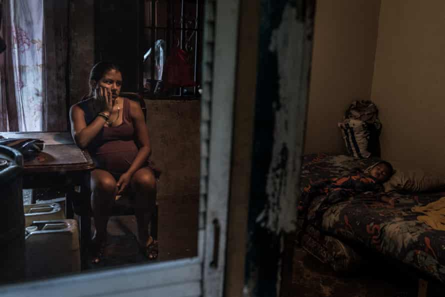 Roxana Gutierrez, 19, watches over her son. When she and her husband Carlos, 20, had steady jobs, it became harder for them to find food, which pushed Carlos to begin stealing motorcycles. He is now serving a prison sentence, and Roxanna is pregnant with their second child