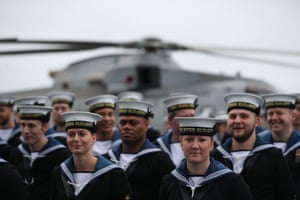Crewmembers muster on the deck