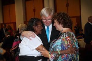 Kevin Rudd and Therese Rein hug Elaine Randall