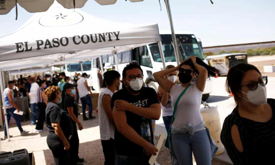 Mexican residents rode busses across the border during a binational Covid-19 vaccination program, in Tornillo, Texas.