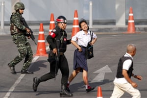 Soldiers rescue a hostage from the mass shooting at the Terminal 21 shopping mall in Nakhon Ratchasima.