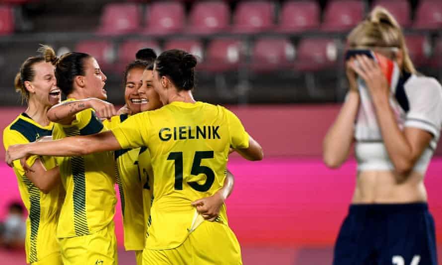 Australia celebrate their fourth goal from Sam Kerr (fourth left) against Team GB.